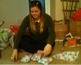 Megan sorting gifts.