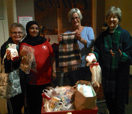 Curves owner, Patricia, with gym members and gifts.