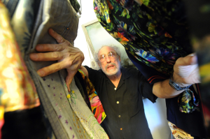 Longtime Tampa resident Michael Braun and his partner were Jimi Hendrix's fashion designers. Braun poses here with some of the clothing that was designed for Hendrix. Among the outfits Braun created is Hendrix's Woodstock outfit that hangs in the Rock and Roll Hall of Fame. JIM REED/STAFF-TAMPA TRIBUNE